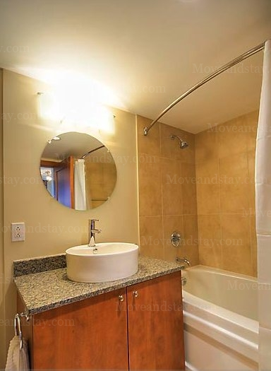 Bathroom 1-Bedroom Apartment 700 Sq.m. Montreal Serviced Apartment