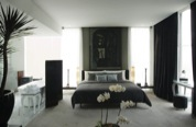 Metropolitan living is given Jakarta's energetic edge, creating a contemporary architectural icon. From the distinctive blue-glass façade through to the mezzanine of three levels, Kemang Icon by Al
