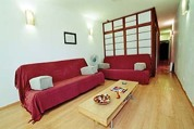 The apartment is on the first floor. There are two japanese style bedrooms (both with double beds), complete with sliding doors and white cloth walls. The living space and fully equipped kitchen are a