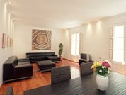 Very spacious - 150 m2 - with parquet floor throughout, high ceilings and several small balconies which look down to the quiet street. The living room is 40 m2 and has 2 leather couches, a satellite T