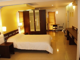 Contemporary Styled Luxury Suites in the Heart of Bangalore. Independent Building with 8 such Suites completely serviced with a Kitchennete in each Suite. This  studio serviced apartment is 150 sq.m ,