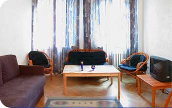 The apartments are located in a historical building only 70 meters from the Old Town main square. The windows of the living room and the bedroom look out onto a picturesque courtyard and a cobbled str
