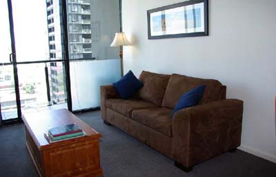 Living Area with inner-spring sofa bed 1-Bedroom Apartment 74 Sq.m. Bayviews at Southbank