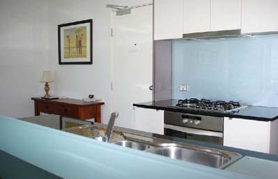 Well-equipped kitchen with dishwasher 1-Bedroom Apartment 74 Sq.m. Bayviews at Southbank