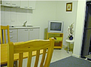 Dining area 1-Bedroom Apartment 38 Sq.m. Central City Accommodation - Melbourne CBD